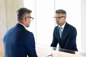 Businessman looking in a mirror